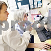 Beck Diefenbach  -  bdiefenbach@daily-chronicle.com<br /> <br /> Registered Nurse Deanna Donnelly, left, talks with Licensed Practical Nurse Carol Rohlena while viewing a patient's data at the DeKalb Clinic in DeKalb, Ill., on Monday April 20, 2009.