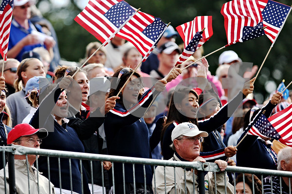 USA fans cheer on their team at the start of the first round of the Solheim Cup on Friday morning.<br /> Rob Winner rwinner@shawsuburban.com