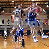 Beck Diefenbach – bdiefenbach@daily-chronicle.com<br /> <br /> St. Charles North's Josh Mikes (23) reaches for a rebound made by Larkin's Ramadon Adili (11) during the second quarter of the IHSA Class 4A Regional playoff game at DeKalb High School in DeKalb, Ill., on Tuesday Feb. 3, 2009.