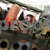 Beck Diefenbach  -  bdiefenbach@daily-chronicle.com<br /> <br /> Ben Anderson, of Waterman, inspects the engine block of his tractor during an engine overhaul in the garage on his homestead in Waterman, Ill. Anderson is against the installation of wind turbines which may surround parts of his property.