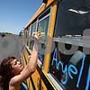 Beck Diefenbach  -  bdiefenbach@daily-chronicle.com<br /> <br /> Genoa-Kingston's Haley Camacho decorates her team's bus at GK High School in Genoa, Ill., on Wednesday May 20, 2009, before leaving for the IHSA State Championships for the high jump.