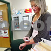 Beck Diefenbach – bdiefenbach@daily-chronicle.com<br /> <br /> Sycamore High School freshman Tracie Lenchow tests her blood sugar in the school's nurse's office prior to going to lunch at Sycamore High School in Sycamore, Ill. Lenchow lives with type 1 diabetes.