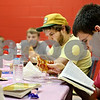 Beck Diefenbach  -  bdiefenbach@daily-chronicle.com<br /> <br /> Morgan Jobe, 19, of DeKalb, reads a part of scripture while eating pizza during a faith lesson and pizza party with local youths at the Salvation Army in DeKalb, Ill., on September 2, 2009.