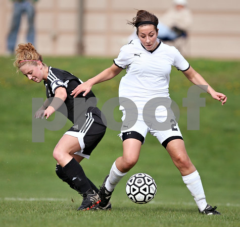 Beck Diefenbach  -  bdiefenbach@daily-chronicle.com<br /> <br /> Sycamore's Nicci Newquist (2) takes he ball from Kaneland's Paige Rogers (2) during the first half of the game at Sycamore High School in Sycamore, Ill., on Friday May 7, 2009. Sycamore beat Kaneland 3 to 0.