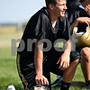 Rob Winner – rwinner@daily-chronicle.com<br /> Ryan Bartels takes a knee during a break on the first day of practice at Sycamore High School.<br /> 08/12/2009