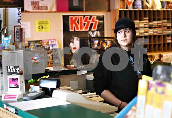 Beck Diefenbach  -  bdiefenbach@daily-chronicle.com<br /> <br /> Store clerk Sarah Girdzins waits for customers at Record Rev in DeKalb, Ill., on Tuesday April 21, 2009. After 35 years, Record Rev is closing it's doors.
