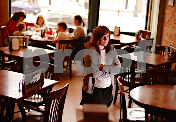 Beck Diefenbach  -  bdiefenbach@daily-chronicle.com<br /> <br /> Erin Finucane, an Athletic Training student at Northern Illinois University, works as a waiter and busser at PJ's Courthouse Tavern in Sycamore, Ill.