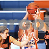 Beck Diefenbach  -  bdiefenbach@daily-chronicle.com<br /> <br /> Genoa-Kingston forward Elizabeth Brown (50) grabs the rebound before Byron's Paige Knodle (4) can get her hands on it during the first quarter of the game at Genoa-Kingston High School in Genoa, Ill., on Tuesday Jan. 27, 2009. Byron beat GK 41 to 38.