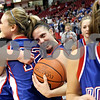 Beck Diefenbach – bdiefenbach@daily-chronicle.com<br /> <br /> Hinckley-Big Rock's Kaitlin Phillips, center, embraces Katie Hollis, left, after defeating Winchester West Central in the Class 1A State Championship at the Redbird Arena in Normal, Ill., on Saturday Feb. 28, 2009.