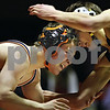 Beck Diefenbach  -  bdiefenbach@daily-chronicle.com<br /> <br /> DeKalb's Tyler Larson battles with Sycamore's Zach Spiewak during the 119 weight class match at DeKalb High School in DeKalb, Ill., on Thursday Jan. 22, 2009.