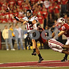 Beck Diefenbach – bdiefenbach@daily-chronicle.com<br /> <br /> Northern Illinois quarterback Chandler Harnish (12) is tackled by Wisconsin's O'Brien Schofield (50) during the fourth quarter of the game in Madison, Wisc., on Saturday Sept. 5, 2009. Wisconsin beat Northern Illinois 28 to 20.
