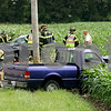 Rob Winner – rwinner@daily-chronicle.com<br /> Emergency personnel, including Cortland and DeKalb Fire Departments, help assist at the scene of an accident near the intersection of Fairview Drive and Somonauk Road in DeKalb on Thursday afternoon.<br /> 07/16/2009