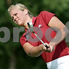 Rob Winner – rwinner@daily-chronicle.com<br /> Jessica Parmenter, of the NIU golf team, hits some practice balls recently at Kishwaukee Country Club.<br /> 08/06/2009