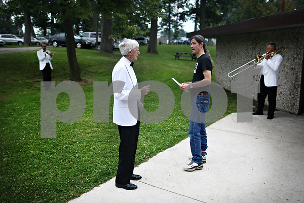 Beck Diefenbach  -  bdiefenbach@daily-chronicle.com<br /> <br /> Dee Palmer talks with sound engineer Rick Calderon before the start of the DeKalb Municipal Band performance in Hopkins Park on Tuesday July 21, 2009.