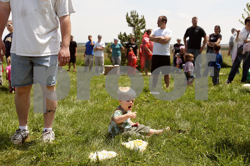 Beck Diefenbach  -  bdiefenbach@daily-chronicle.com<br /> <br /> Declan Anderson, 2, of Cortland, enjoys some pie before the start of the world's largest pie fight in Genoa, Ill., on Saturday June 13, 2009. Over 200 people participated.