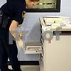 Rob Winner – rwinner@daily-chronicle.com<br /> Deputy Kelly King of the DeKalb County Sheriff's Office prepares medication doses for the inmates at the jail in Sycamore on Wednesday November 11, 2009.<br /> 11/11/2009