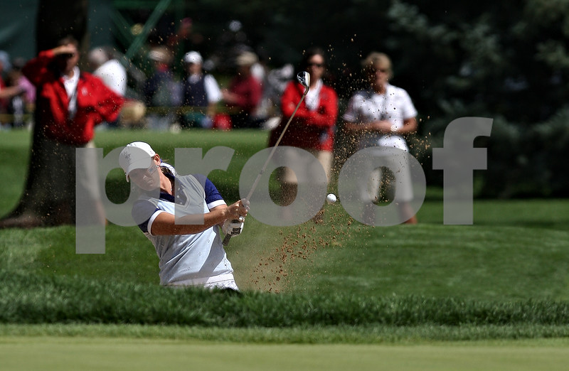 Beck Diefenbach  -  bdiefenbach@daily-chronicle.com<br /> <br /> USA's Kristy McPherson chips out of a bunker on the 10th hole during the match against team Europe at the Solheim Cup in Sugar Grove, Ill., on Saturday Aug. 22, 2009.