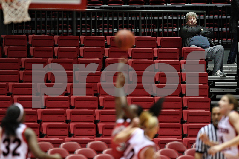 Beck Diefenbach  -  bdiefenbach@daily-chronicle.com<br /> <br /> A patron watches as Northern Illinois takes on Ball State at the Convocation Center in DeKalb, Ill., on Wednesday Jan. 21, 2009.