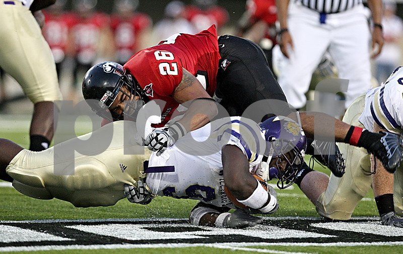 Rob Winner –  rwinner@daily-chronicle.com<br /> Northern's Cory Hanson tackles Western's Dre Gibbs in the first half. Northern Illinois defeated Western Illinois 41-7 in DeKalb on Saturday night.<br /> 09/12/2009