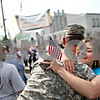 Beck Diefenbach  -  bdiefenbach@daily-chronicle.com<br /> <br /> Jodi Riley, of Sycamore, hugs her husband Clayton as the 122nd Field Artillery SECFOR Team marches to the National Guard armory in Sycamore, Illl., on Monday June 1, 2009.