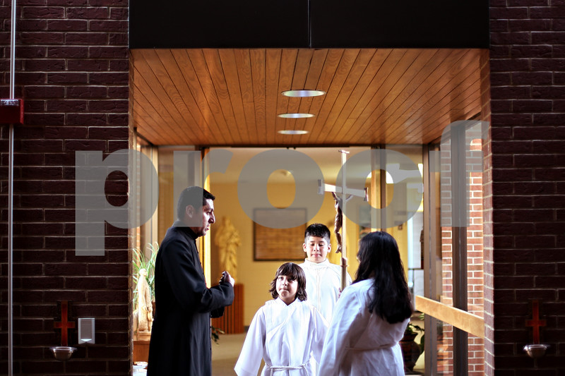Beck Diefenbach  -  bdiefenbach@daily-chronicle.com<br /> <br /> Seminarian Juan Ayala discusses how to properly hold the cross with his alter servers in training during class at St. Catherine's of Genoa Church on Wednesday June 17, 2009.