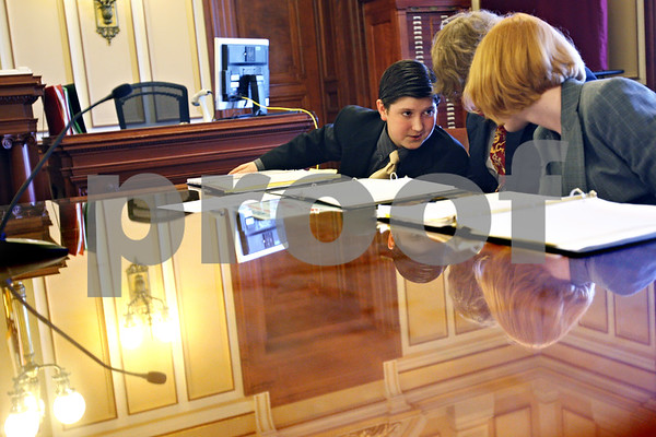 Beck Diefenbach  -  bdiefenbach@daily-chronicle.com<br /> <br /> DeKalb's Classical Conversation mock trial team members (from left) Joel Dik, 13, Isaac Chapman, 15, and Kristen Nielsen, 13, talk amongst themselves during their mock murder trail against the Freeport team at the DeKalb County courthouse in Sycamore, Ill., on Wednesday May 20, 2009.