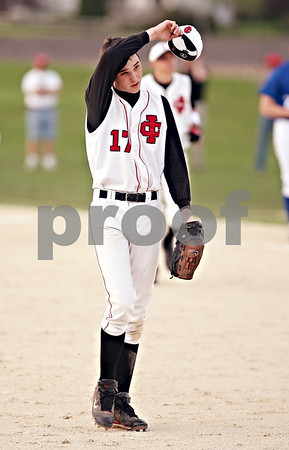 Beck Diefenbach  -  bdiefenbach@daily-chronicle.com<br /> <br /> Indian Creek pitcher Josh Lazzarotto (17) wipes his forehead after his team beats Hinckley-Big Rock 7 to 1 at Indian Creek in Shabbona, Ill., on Monday May 4, 2009. pitched all 7 innings.