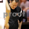 Beck Diefenbach  -  bdiefenbach@daily-chronicle.com<br /> <br /> DeKalb head coach Dave Rohlman reacts as DeKalb's leads begins to shrink during the fourth quarter of the game against Hampshire at DeKalb High School on Tuesday Dec. 22, 2009. DeKalb defeated Hampshire 58 to 50.