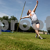 Rob Winner – rwinner@daily-chronicle.com<br /> Jen Milroy practices throwing the javelin during a recent practice at DeKalb High School. Sisters Stephanie & Jen Milroy qualified for the Junior Olympic nationals with the Huskie Track Club.<br /> 07/24/2009