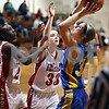 Beck Diefenbach  -  bdiefenbach@daily-chronicle.com<br /> <br /> Somonauk's Lauren Brummel (35) shoots the ball over Indian Creek's Lauren Anderson (33, center) and Michelle Crayton (24) during the third quarter of the game at Indian Creek High School in Shabbona, Ill., on Thursday Dec. 10, 2009. Somonauk came back from behind to defeat Indian Creek 49 to 47.