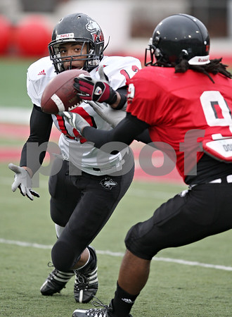 Beck Diefenbach  -  bdiefenbach@daily-chronicle.com<br /> <br /> Northern Illinois wide receiver Willie Clark (12) and defensive back Donald Smith (9) during practice at Huskie Stadium in DeKalb, Ill., on Tuesday April 14, 2009.