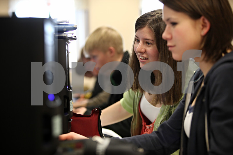 Beck Diefenbach  -  bdiefenbach@daily-chronicle.com<br /> <br /> Seniors Olivia Kevin, far right, and Emily Harnden discuss stock they are researching during their consumer economics class at Sycamore High School in Sycamore, Ill., on Thursday Feb. 5th, 2009. The class is playing the stock market game, which entails spending $100,000 dollars on stocks and tracking the changes.