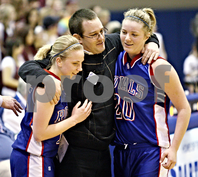 Beck Diefenbach – bdiefenbach@daily-chronicle.com<br /> <br /> Hinckley-Big Rock head coach Greg Burks hugs Jes Meyer (15) and Jenna Thorp (20) during the final moments of the fourth quarter of the 1A Super Sectional game at Elgin Community College in Elgin, Ill., on Monday Feb. 23, 2009.