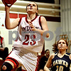 Rob Winner – rwinner@daily-chronicle.com<br /> Indian Creek's Katie Browder puts up two after stealing a pass intended for Hiawatha's Cassie Lutz during the second quarter on Thursday December 17, 2009 in Shabbona, Ill.