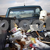 Beck Diefenbach  -  bdiefenbach@daily-chronicle.com<br /> <br /> DeKalb Park District Maintenance workers Steve Knutzen, left, and Rock Alms dump their trash into the back of their truck in Pappas Park in DeKalb, Ill., on Friday Feb. 13, 2009. The clean-up is part of a the Park District's efforts to begin spring cleaning.