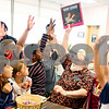 Beck Diefenbach  -  bdiefenbach@daily-chronicle.com<br /> <br /> Homer Grady, of DeKalb, asks visiting group of second graders if they know what is in his hand during a show and tell at the DeKalb Senior Center in DeKalb, Ill., on Thursday May 28, 2009. Grady was holding up a vinyl record.