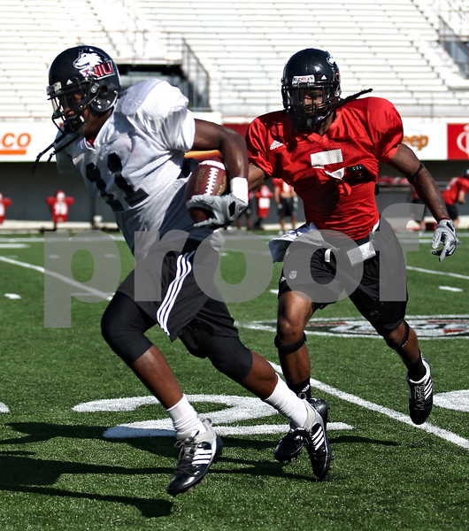 Beck Diefenbach  -  bdiefenbach@daily-chronicle.com<br /> <br /> Wide Receiver Marcus Lewis (11) and defensive back Chris Smith (5) during practice at Huskie Stadium of Northern Illinois University in DeKalb, Ill., on Tuesday Sept. 1, 2009.