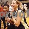Beck Diefenbach  -  bdiefenbach@daily-chronicle.com<br /> <br /> Sycamore's Lake Kwaza (11, left) and Ashley Berlinski (20) rejoice following their defeat of DeKalb, 38 to 33, following the game at DeKalb High School in DeKalb, Ill., on Tuesday Dec. 1, 2009.