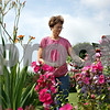 Rob Winner – rwinner@daily-chronicle.com<br /> Barb Lindholm of Clare deadheads her flower garden on Saturday afternoon.<br /> 08/08/2009