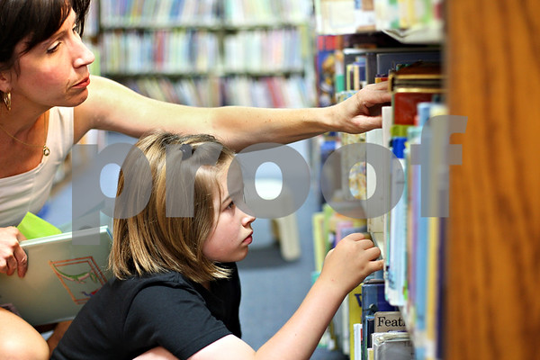 """Beck Diefenbach  -  bdiefenbach@daily-chronicle.com<br /> <br /> Patricia Klonoski, of DeKalb, helps her daughter Olivia, 8, look for summer reading books at the DeKalb Public Library on Monday June 15, 2009. """"Stocking up on summer reading,"""" Klonoski said."""