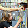 "Beck Diefenbach  -  bdiefenbach@daily-chronicle.com<br /> <br /> Patricia Klonoski, of DeKalb, helps her daughter Olivia, 8, look for summer reading books at the DeKalb Public Library on Monday June 15, 2009. ""Stocking up on summer reading,"" Klonoski said."