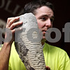 Rob Winner – rwinner@daily-chronicle.com<br /> Before heading out to the quarry for Saturday's fossil dig, Dan Larson, plant manager at the Vulcan Materials quarry in DeKalb, holds up a fossil as an example of what could be found.<br /> 08/08/2009