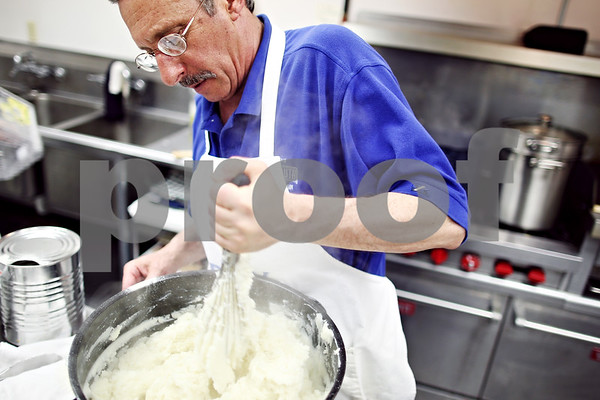 Beck Diefenbach  -  bdiefenbach@daily-chronicle.com<br /> <br /> Louis Schoenburg, of Sycamore, prepares mashed potatoes during a Passover seder meal hosted by Congregation Beth Shalom in DeKalb, Ill., on Thursday April 9, 2009.