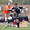 Beck Diefenbach  -  bdiefenbach@daily-chronicle.com<br /> <br /> DeKalb's Cody Varga (18, left) and Kaneland's Alex Gil (8) battle over a ball during the first half of the game at DeKalb High School in DeKalb, Ill., on Monday Sept. 28, 2009.