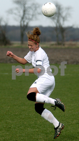 Rob Winner – rwinner@daily-chronicle.com<br /> Kaneland's Paige Rogers uses her head to keep the ball out of the Knights' territory in the first half against Indian Creek on Thursday. Kaneland defeated Indian Creek 2-0.<br /> 04/23/2009