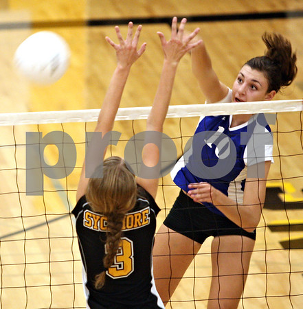 Beck Diefenbach  -  bdiefenbach@daily-chronicle.com<br /> <br /> Geneva Lauren Wicinski (10) spikes the ball during the second game of their match against Sycamore High School in Sycamore, Ill., on Thursday Sept. 17, 2009. Geneva beat Sycamore 2-0.