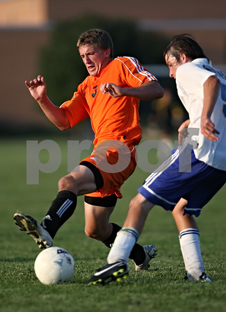 Beck Diefenbach  -  bdiefenbach@daily-chronicle.com<br /> <br /> DeKalb's Sam Dumbacher (3, left) fights for the ball against Somonauk's Alec Ziupsnys (5) for the ball during the second half of the game at Somonauk High School in Somonauk, Ill., on Monday Sept. 14, 2009. DeKalb beat Somonauk 2-0.