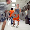 Beck Diefenbach – bdiefenbach@daily-chronicle.com<br /> <br /> DeKalb High School senior Kyle Wallin watches as sophomore Paul Paitek runs by while rehearsing baton hand offs during practice at DeKalb High School in DeKalb, Ill., on Tuesday March 10, 2009.