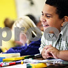 Beck Diefenbach  -  bdiefenbach@daily-chronicle.com<br /> <br /> Hiawatha fifth grader Kenny Taylor laughs during during his first day of school in Kirkland, Ill., on Tuesday Aug. 18, 2009.