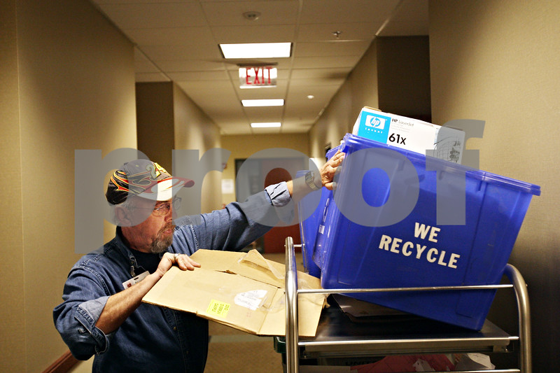 Beck Diefenbach  -  bdiefenbach@daily-chronicle.com<br /> <br /> Jim Olesen, of DeKalb, collects cardboard and paper for recycling while volunteering at Kishwaukee Hospital in DeKalb, Ill., on Monday Oct. 12, 2009. Olesen began volunteering at the hospital after he lost his job in September of 2008.